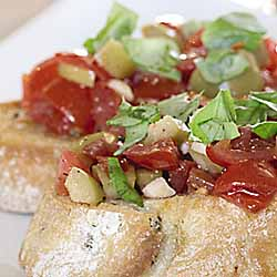 Garlic Stuffed Olive & Tomato Bruschetta with Arugula