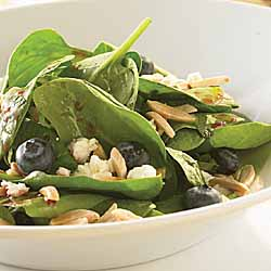 Spinach Salad With Blueberries, Feta Cheese, Slivered Almonds and Berry Mint Dressing